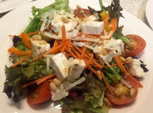 Healthy salad with Mozzarella, Feta, pine nuts and raspberry balsamic vinaigrette